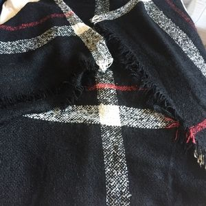 Black acrylic poncho with roll neck